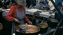 Ecuador 1970: woman cooks at the market Stock Footage