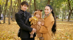 Young parents with the child in the woods on the photo session Stock Footage