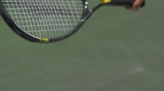 Close-up of young man holding tennis racquet in hand, slow motion. Stock Footage