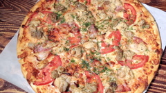 Baked meat and tomato pizza Stock Footage