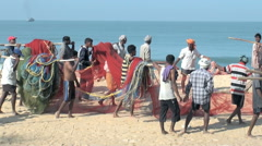 The indian fishermen carrying on their shoulders the big and heavy nets Stock Footage