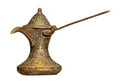Retro brass arabian coffee pot isolated on white. Stock Photos