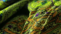 Indian textile with ornament. close-up. colored cloth Stock Footage