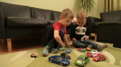 Two Guys Playing With Toy Cars Stock Footage