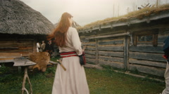 People Dressed in Medieval Clothing Role Play Life of Scandinavian Civilians  Stock Footage