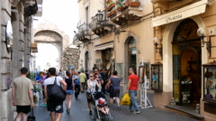 May tourists shopping in the main street corso umberto of taormina Stock Footage