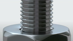 Macro shot of rotating screw and nut. Stock Footage