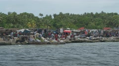 Haitian Marketplace seen from the water Stock Footage