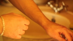 The man wipes his hands with a towel Stock Footage