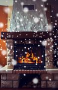 Close up of burning fireplace with snow Stock Photos
