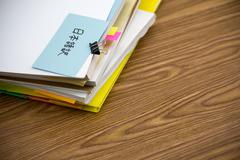 Japanese Translation; The Pile of Business Documents on the Desk Stock Photos