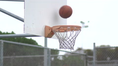 An outdoor basketball hoop at a local park. Stock Footage