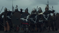 Shot of Advancing Army of Vikings Holding Shields. Stock Footage