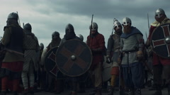 Army of Vikings are Raising Swords and Crying Before Battle Stock Footage