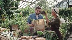 Helpful Shop Assistant in Farm Market Stock Footage