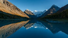 Time Lapse. The Mountain Belukha in the reflection Akkem lake at sunset. Stock Footage
