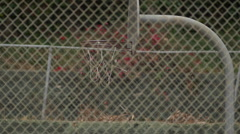 A young man basketball player dunking on an old outdoor basketball hoop, slow mo Stock Footage