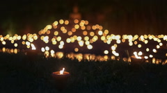 Asian candles in religious ceremony Stock Footage