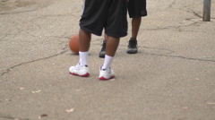 A young man basketball player dunking while playing one on one, slow motion. Stock Footage