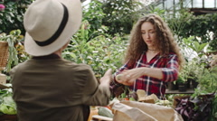 Girl Buying Fresh Food at Farm Market Stock Footage