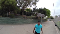 POV of two young men playing basketball together, slow motion. Stock Footage