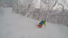 Young man skier skiing in the mountains on fresh powder, slow motion. Stock Footage