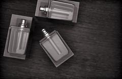 Perfume bottles on the wooden background. Stock Illustration
