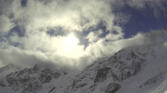 Snow covered mountain peaks, slow motion. Stock Footage