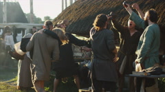 Dressed in Medieval Clothing Group of People Drinking, Dancing and Celebrating. Stock Footage
