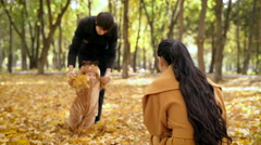 Child with dad walking in the autumn forest Stock Footage