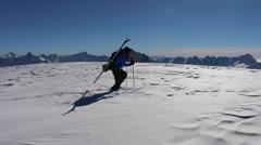 Young man skier hiking through deep snow. Stock Footage