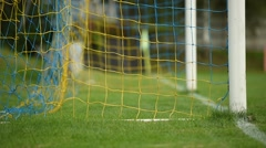 A soccer ball enters in a soccer goal during training Stock Footage