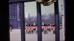 1967: buckingham palace changing of the guards filled through a gate LONDON Stock Footage