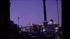 1967: double decker bus parked while traffic goes by in england. LONDON ENGLAND Stock Footage