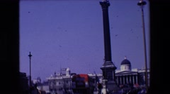 1967: high rise pillar zoom in statue of man with sword on top LONDON ENGLAND Stock Footage