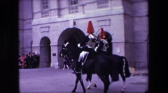 1967: men horses riding towards castle red cap black horses people standing Stock Footage