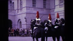 1967: army troops riding horse people standing castle watching flags Stock Footage