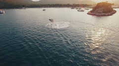 Aerial View of Jet Ski Rides in a Bay on Sunset Stock Footage