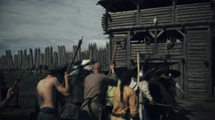Army of Viking Warriors Assaulting Wooden Fortress during Slavs and Vikings  Stock Footage