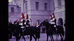 1967: buckingham palace mounted soldiers in full dress uniform performing  Stock Footage