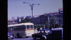 1967: busy traffic passes by city with statue MADRID SPAIN Stock Footage