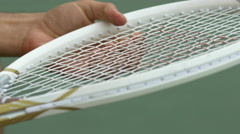 Man adjusting the strings on a tennis racket. Stock Footage