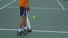 A experienced tennis player serving to a beginner tennis player. Stock Footage