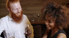 Hipster with a ginger beard flirts with a very beautiful cheerful black woman in Stock Footage