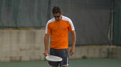 Male tennis player bouncing tennis ball with racket , slow motion. Stock Footage