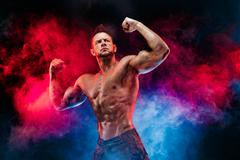 Strong bodybuilder man in military pants with perfect abs, shoulders,biceps Stock Photos