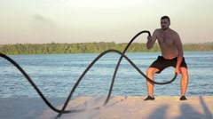 Battle ropes on the banks of the river. Slow motion Stock Footage