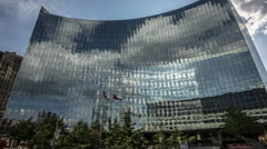Time Lapse building cloudy reflection Stock Footage