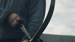 Medieval Archer Draws a Bowstring, Aims and Makes a Shot. Medieval Reenactment. Stock Footage