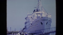 1967: a large white ship is tethered to a dock in a port on a sunny day. PALERMO Stock Footage